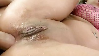 Oiled Bitch Gets Her Ass Rammed