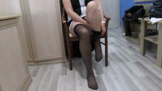 Girl Puts On Stockings