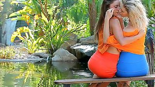 Two Young Girlfriends Guerlain And Madonna Are Getting Horny Outdoors By The Lake, Girls Are Naughtily Kissing And Hotly Fondling Each Other