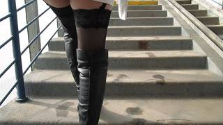 Chick In Black Boots And Black Stockings Going Upstairs