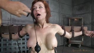 gorgeous and busty redhead brought to her knees