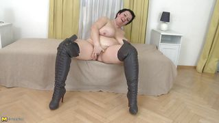 Black Hair, Black Boots And A Black Dildo