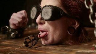 Locked In Shackles With Her Tongue Clamped