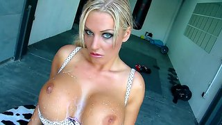 A Busty Blonde Plays With A Gallon Of Milk