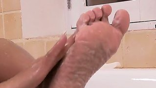 Slender Ebony Hottie Adores Having Solo Fun When Sitting In The Soapy Water In The Bathroom
