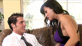 Chris Johnnson And Lisa Ann Making Out On A Sofa