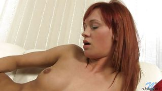 Sensual Redhead Plays With Herself
