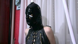 Blonde German Babe In Black Leather Bondage Gear With Gimp Mask