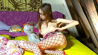 Pale Skinned Schoolgirl Gloria In Sexy Glasses And Fishnet Pantyhose Gets Her Pussy Off