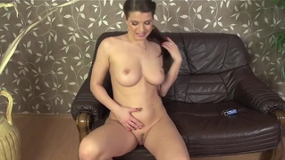Mona Lee Squirts On The Couch